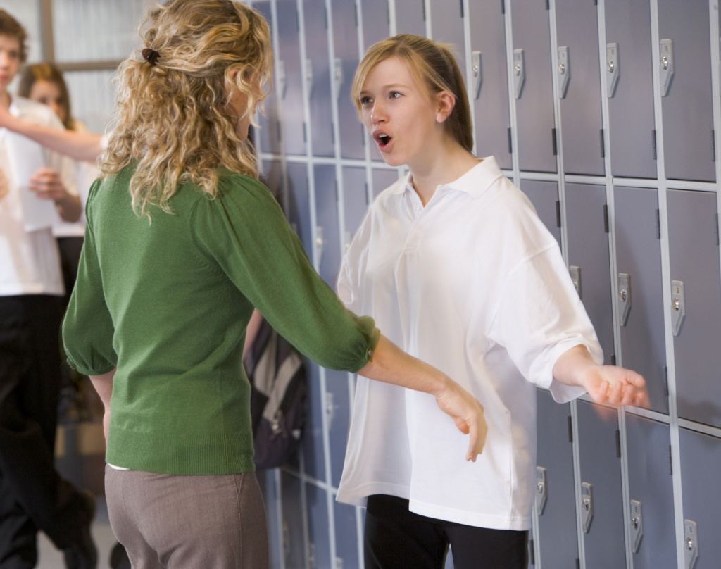 Girl student having confrontation with the teacher