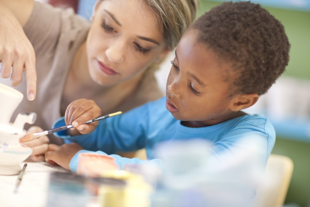 Young boy working with the teacher