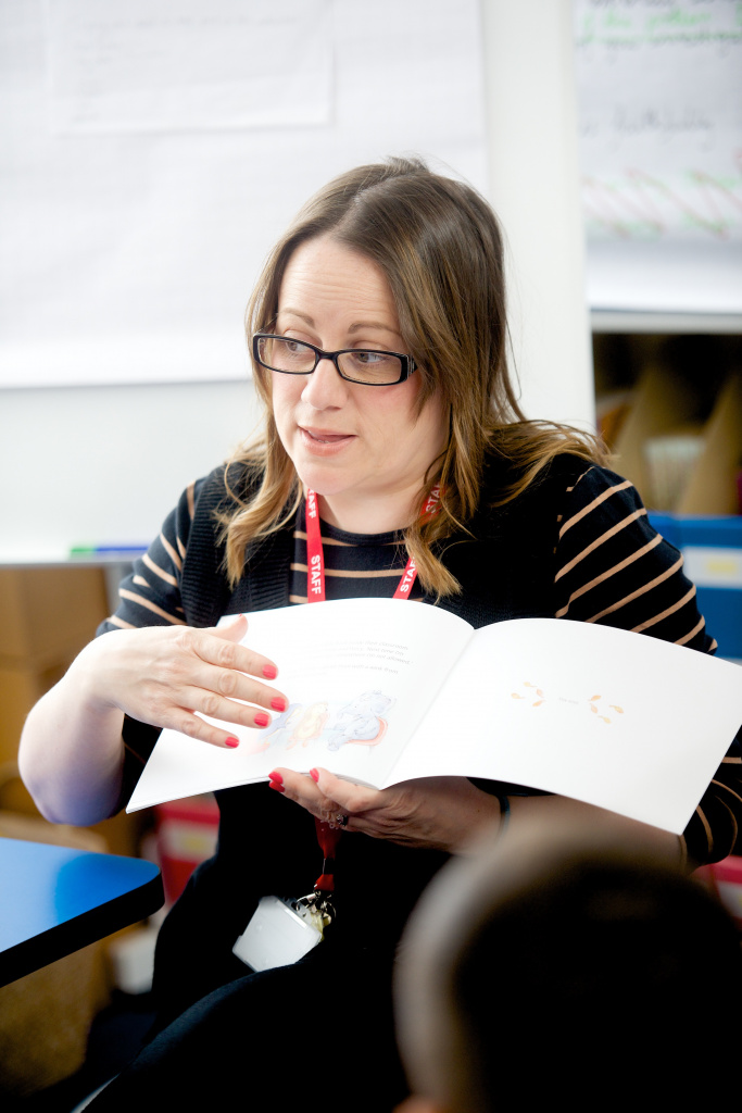 Teacher reading to pupils