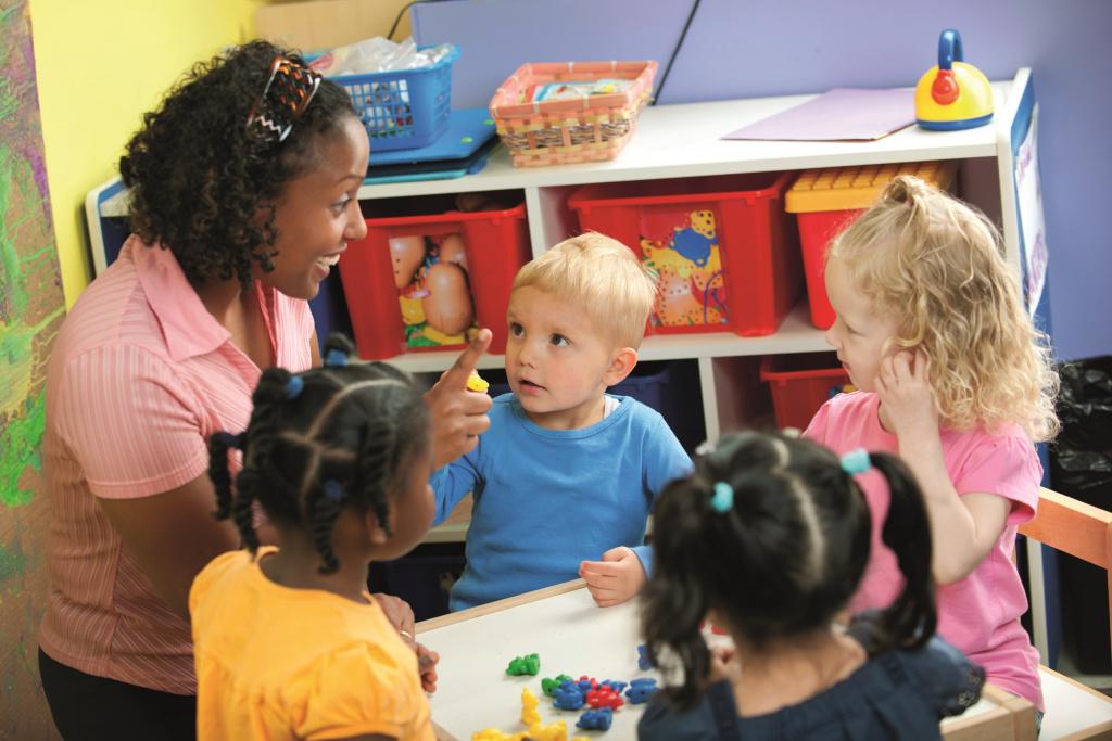 Teacher with pre-school children
