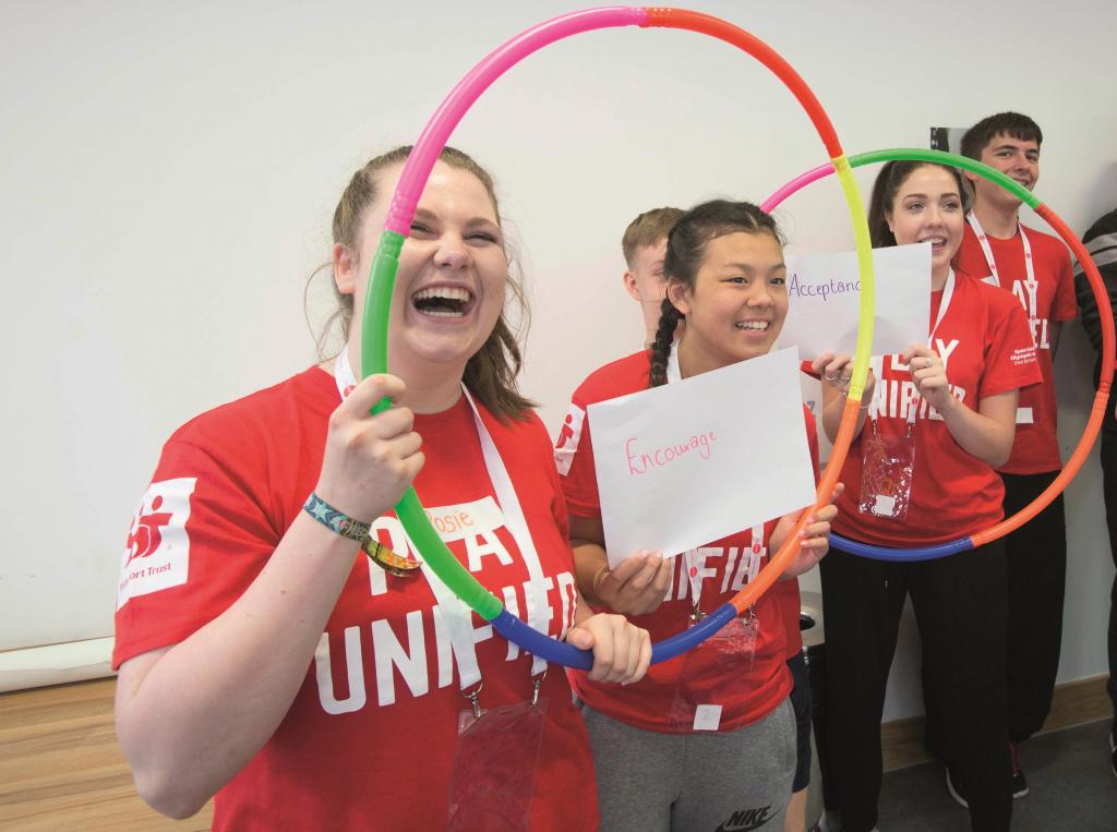 Teenagers holding hula hoops