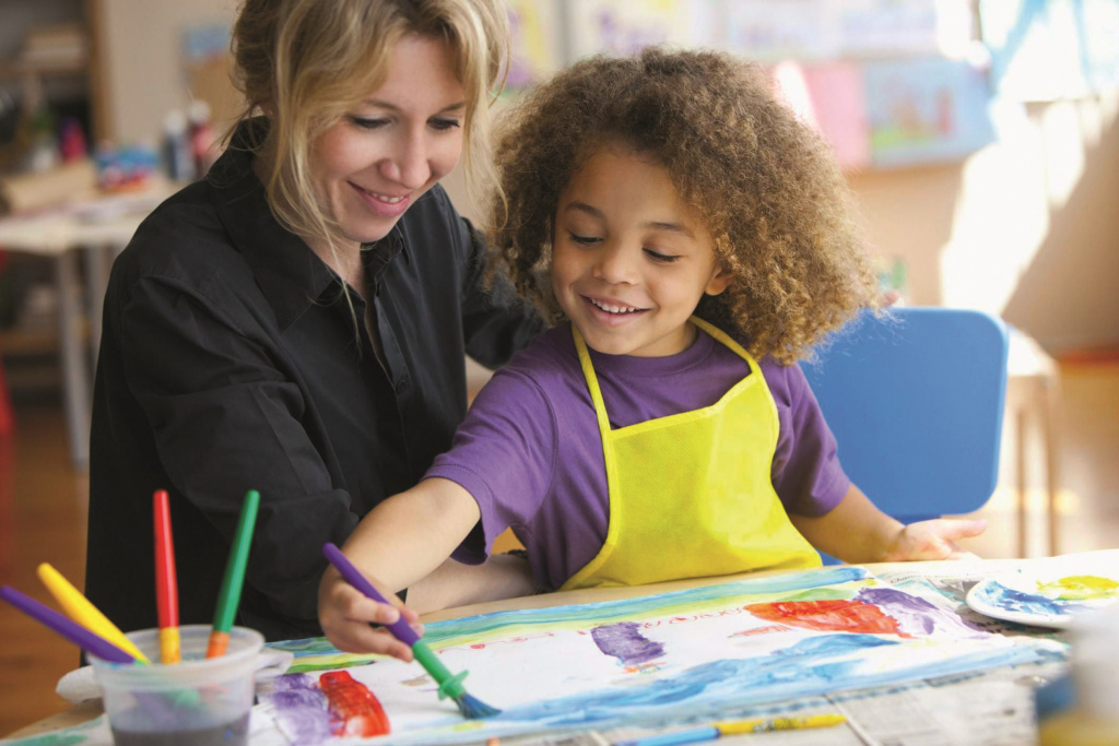 Adult with nursery child painting