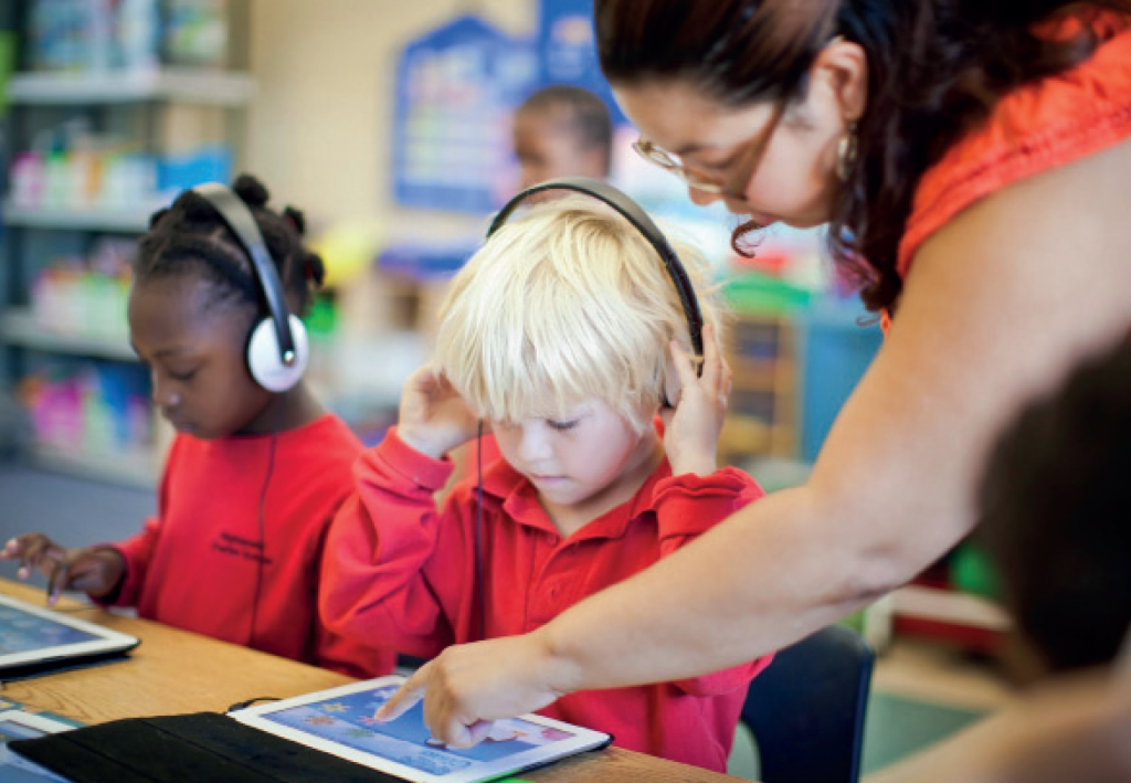 young pupils with headphones and tablets