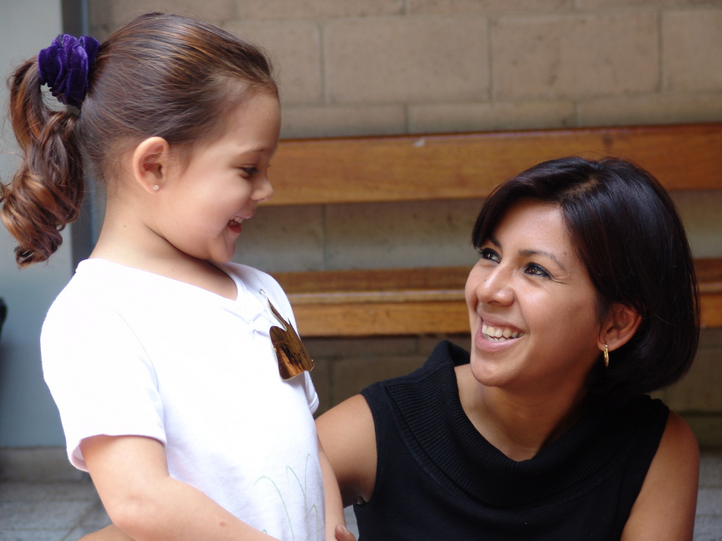 Woman with pre-school girl smiling