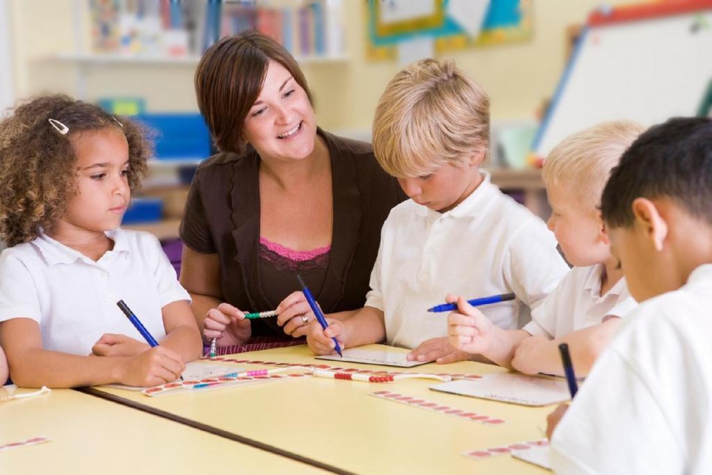teacher with nursery children