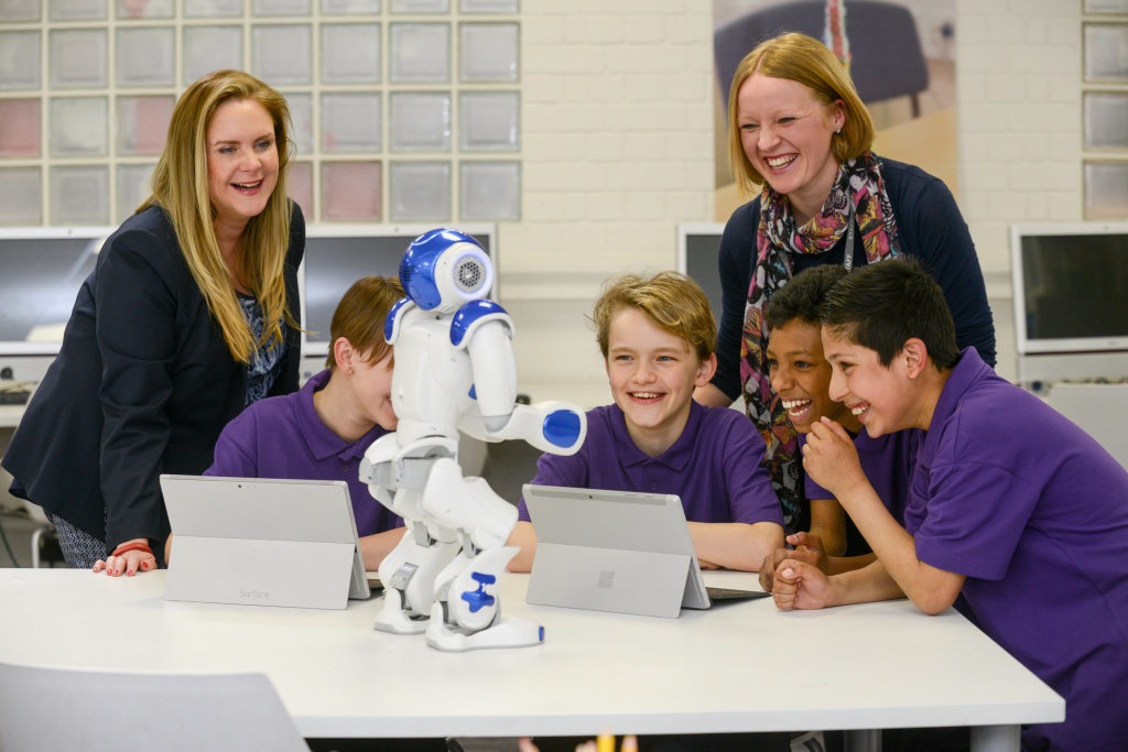 Pupils and teacher with robot