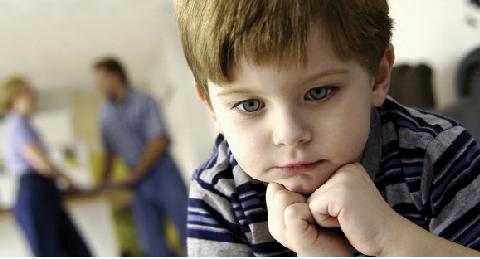 pre-school boy in deep thought