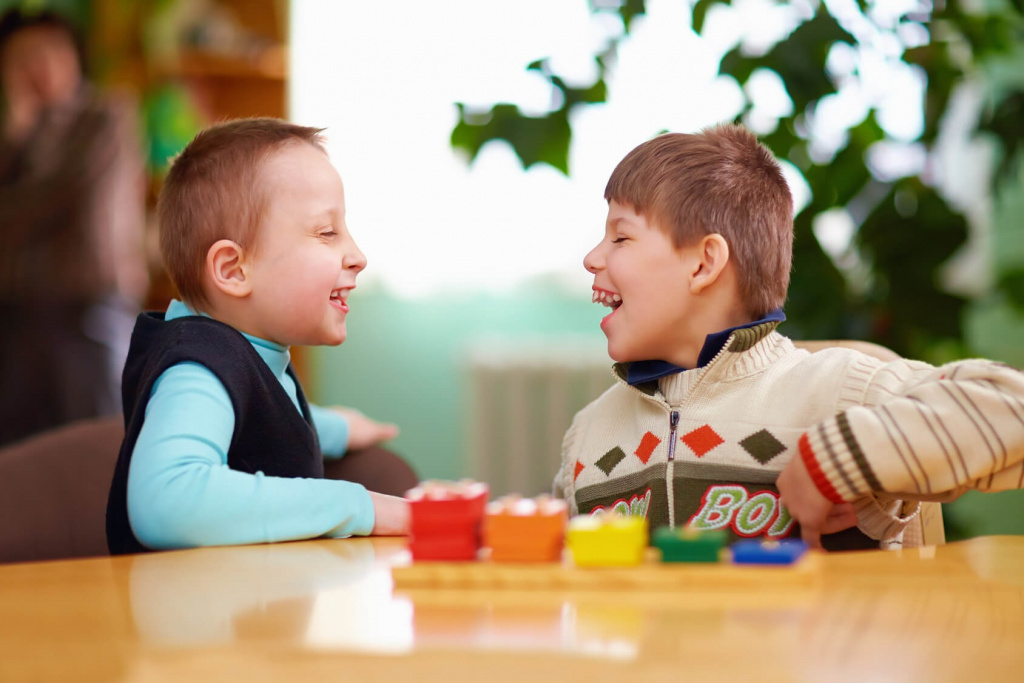 SEN Children at desk smiling