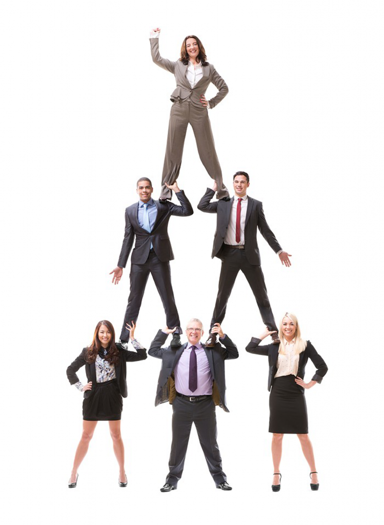 Colleagues standing on each other