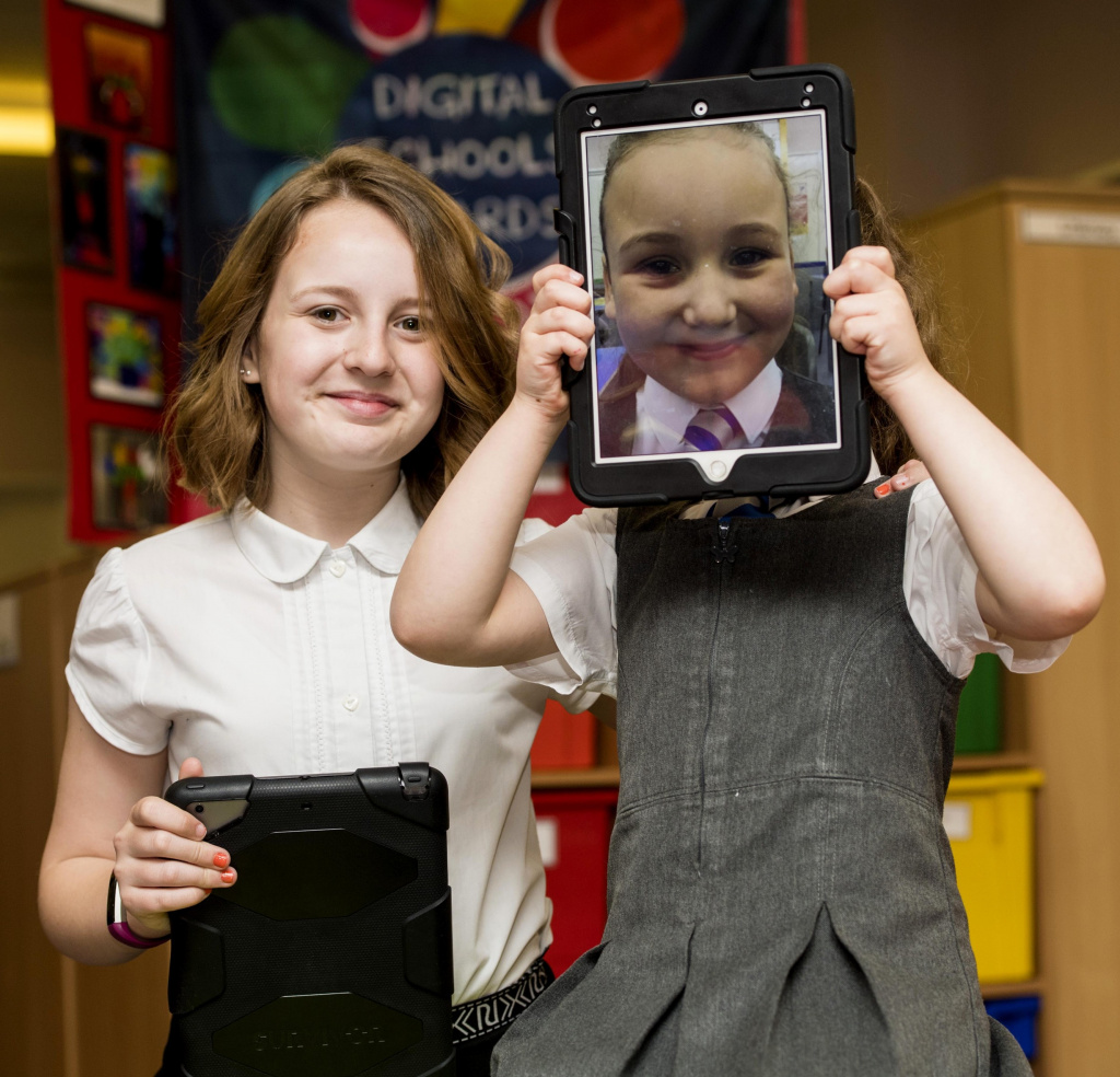 Young pupils with tablets