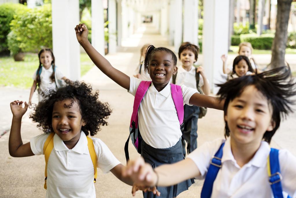 Happy young school children