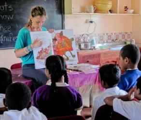 Teacher showing students a cartoon