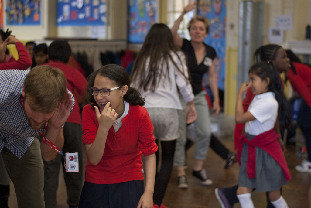 Pupils having fun with teachers at New City Primary