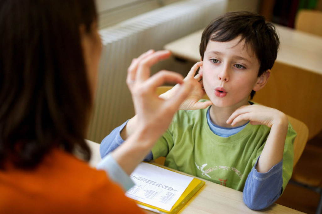Young boy in speech lesson