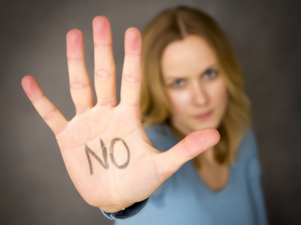 Woman with 'no' on palm