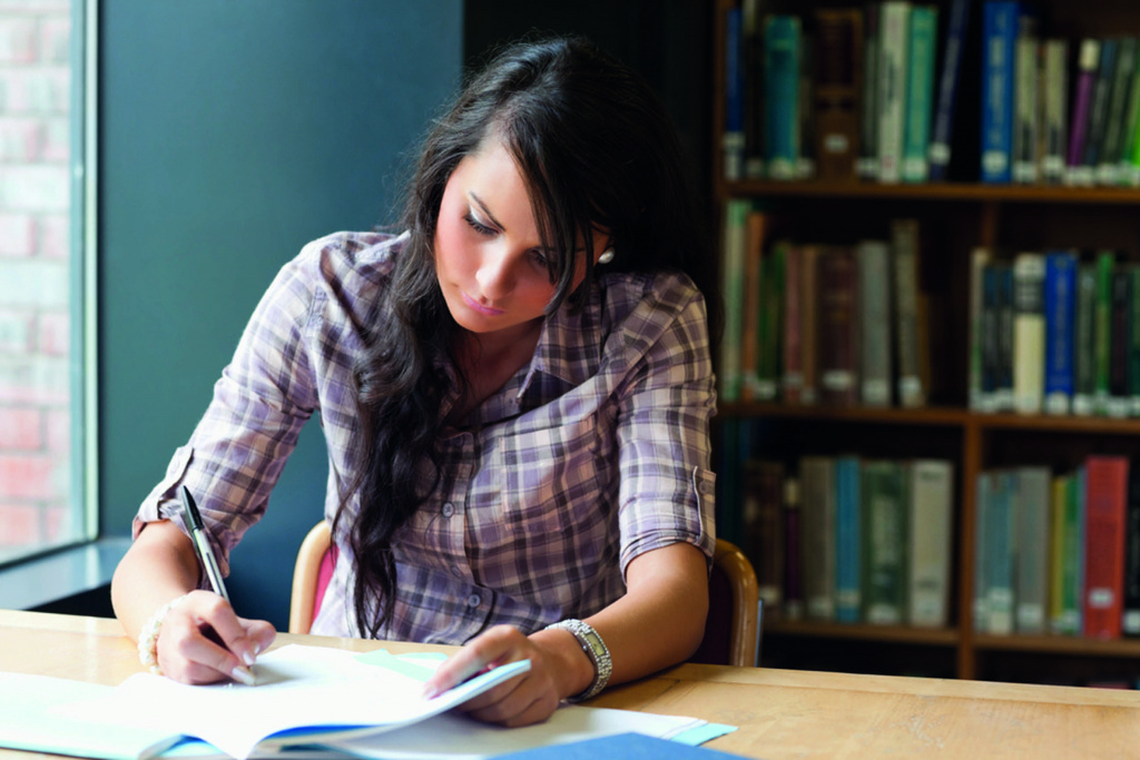 Female student studying alone