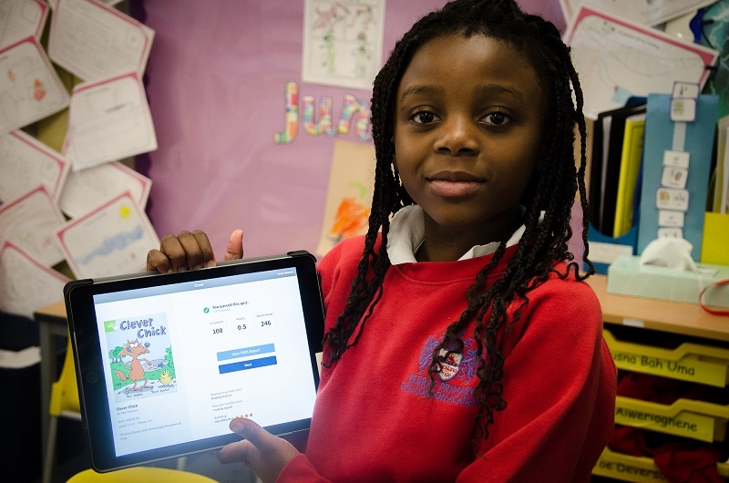 Girl proudly showing screen on her tablet