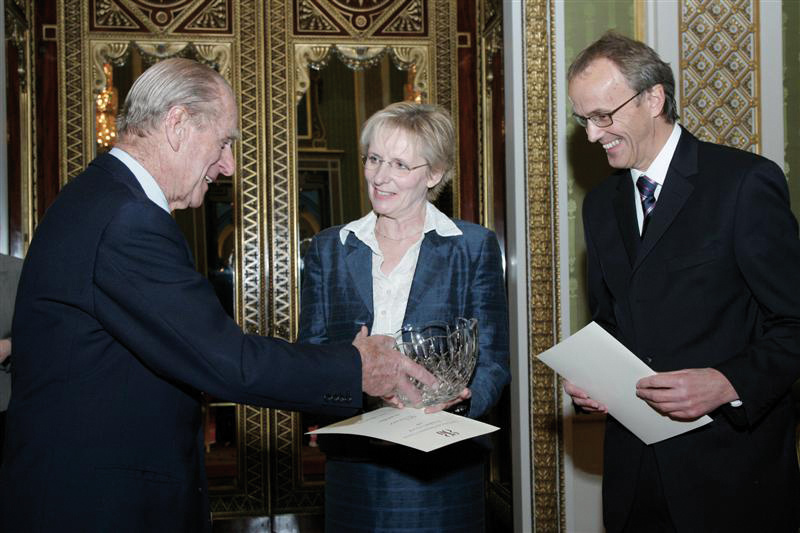 Prince Philip presenting award to John and Ann Crick