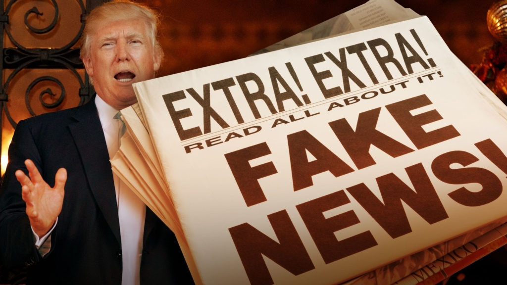 picture of Donald Trump with newpspaer saying Extra Extr, Read All About it Fake News