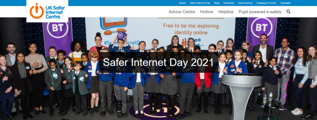 Children and adults from many nations with a baner saying Internet Safety Day 2021