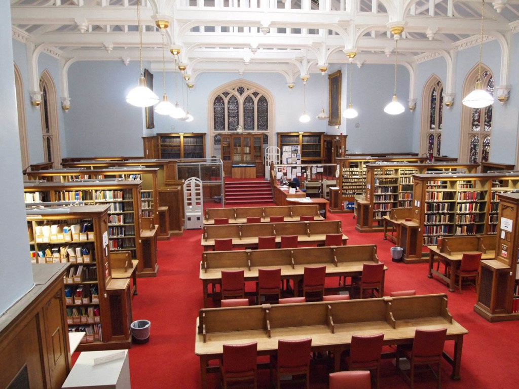 A traditional library with book stacks and study desks