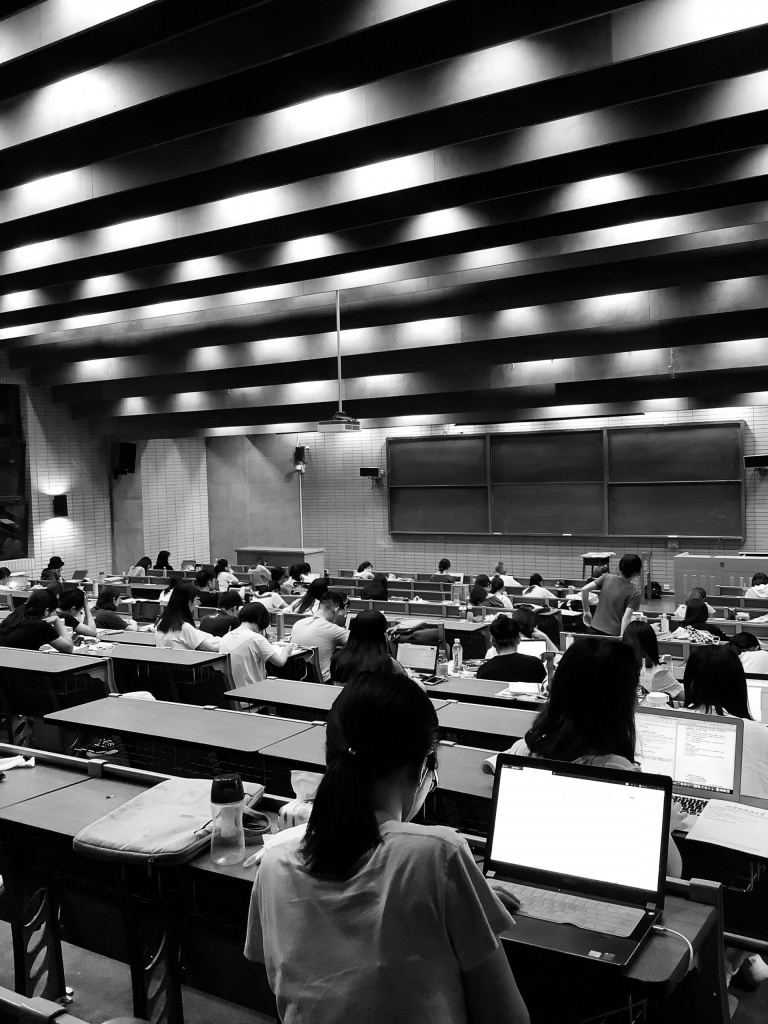 black and white image of students with laptops